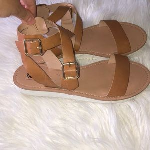 Tan sandals with gold buckles